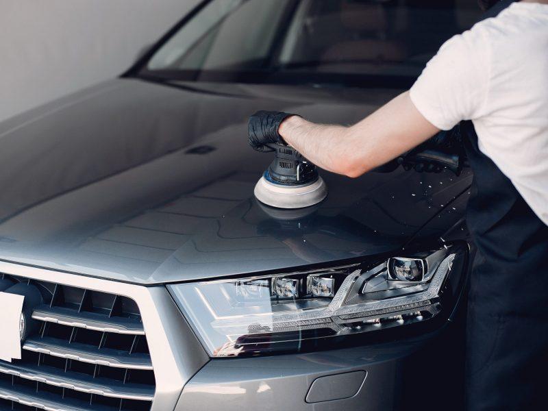 man-polish-car-garage-min
