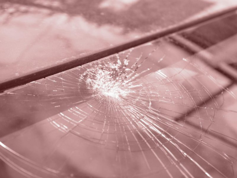 broken-windshield-with-lot-cracks-small-glass-pieces-damaged-car-min-scaled-retro